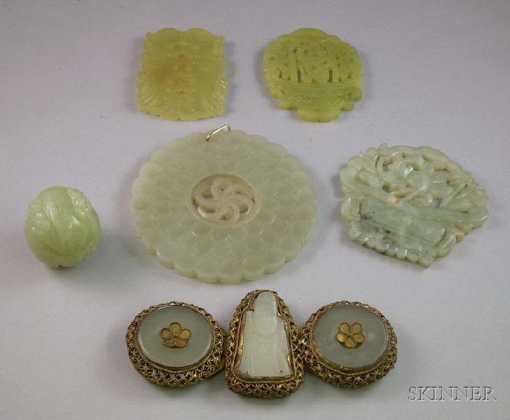 Carved Jade Belt Buckle and Bead and Four Carved and Pierced Jade Pendants.