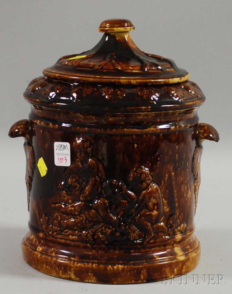 Large Rockingham Glazed Molded Pottery Jar with Cover