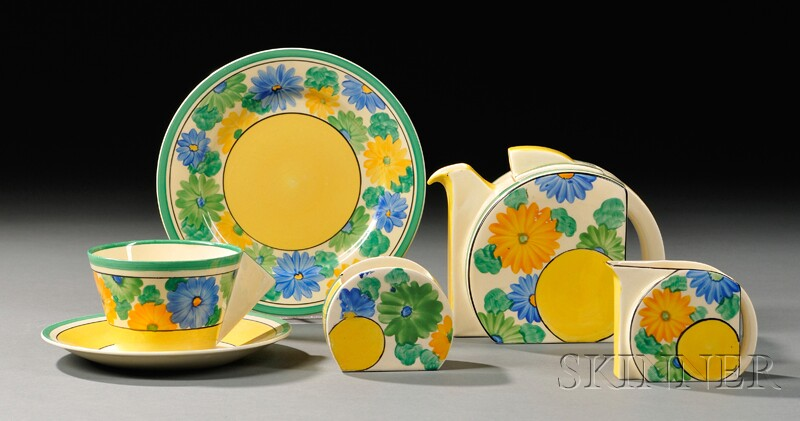 Five-piece Clarice Cliff Bizarre Ware Partial Tea Set