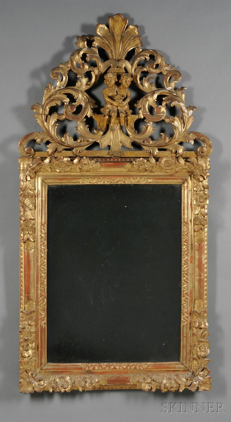 Figural Giltwood Mirror