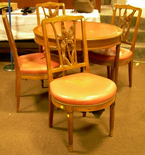 Set of Four Provincial Louis XVI Style Salmon-colored Leather Upholstered Carved Walnut Chairs and Circular Tab...