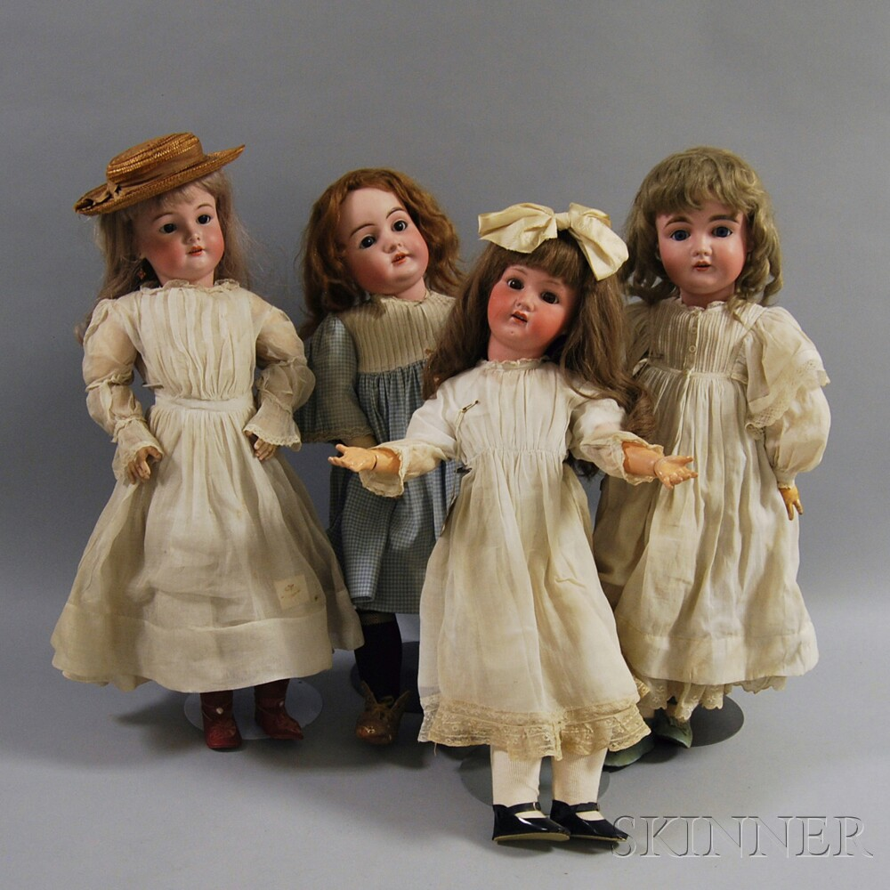 Four German Bisque Head Girl Dolls