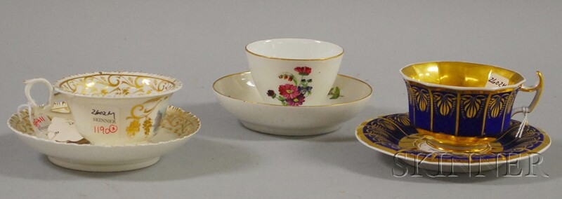 Berlin Matte Blue and Gilt-decorated Cabinet Cup and Saucer, and Two Gilt and Hand-painted View-and Floral-decorated Porcelain Cups and