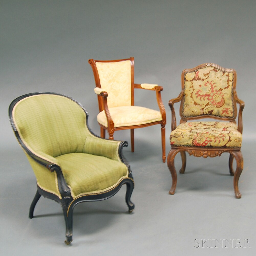 Three Carved and Upholstered Armchairs