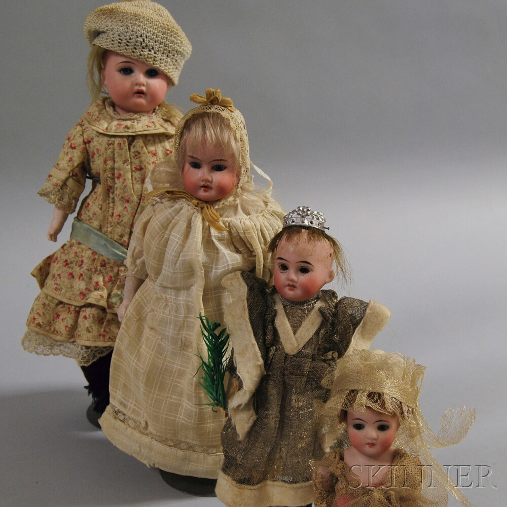 Four Small Dolls