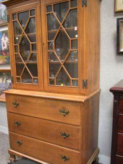 Chippendale-style Glazed Maple Stepback Cupboard.