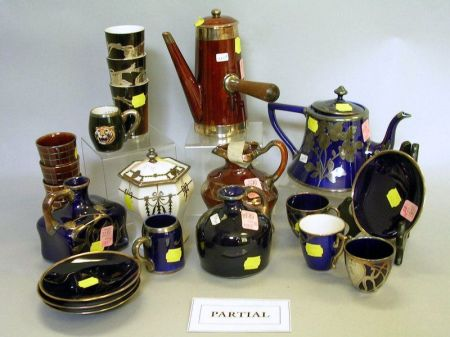 Forty-four Pieces of Silver Overlay Glazed Porcelain Tableware.