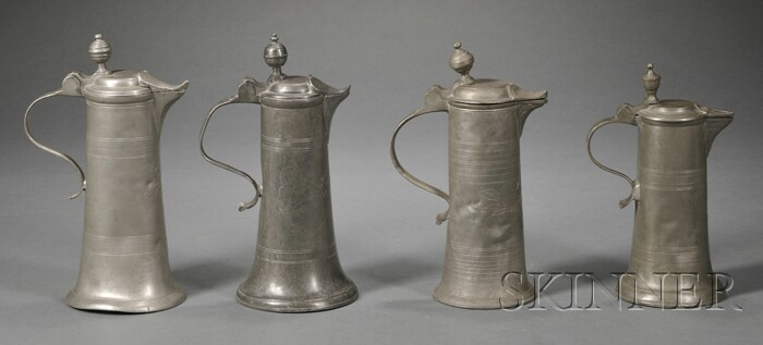 Four Trumpet-shaped Pewter Flagons