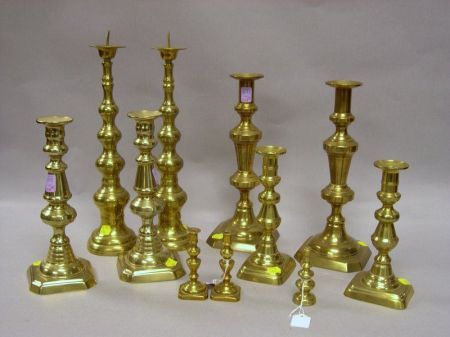 Eleven Brass Candlesticks