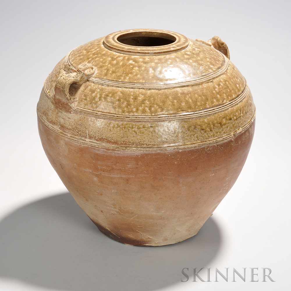 Ash-glazed Storage Jar, China, possibly Han dynasty, the bulbous form widening at the shoulders, with two incised strap handles, the up