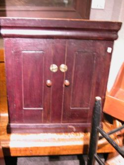 Small Brown Stained Pine Two-Door Cabinet.