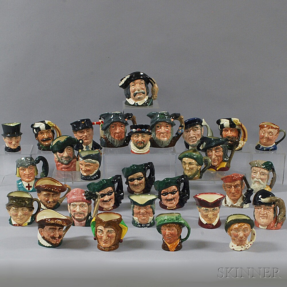 Thirty Doulton Face Jugs