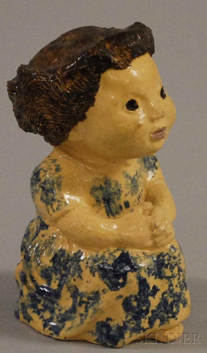 Cobalt Blue Sponge-decorated Pottery Figure of a Girl