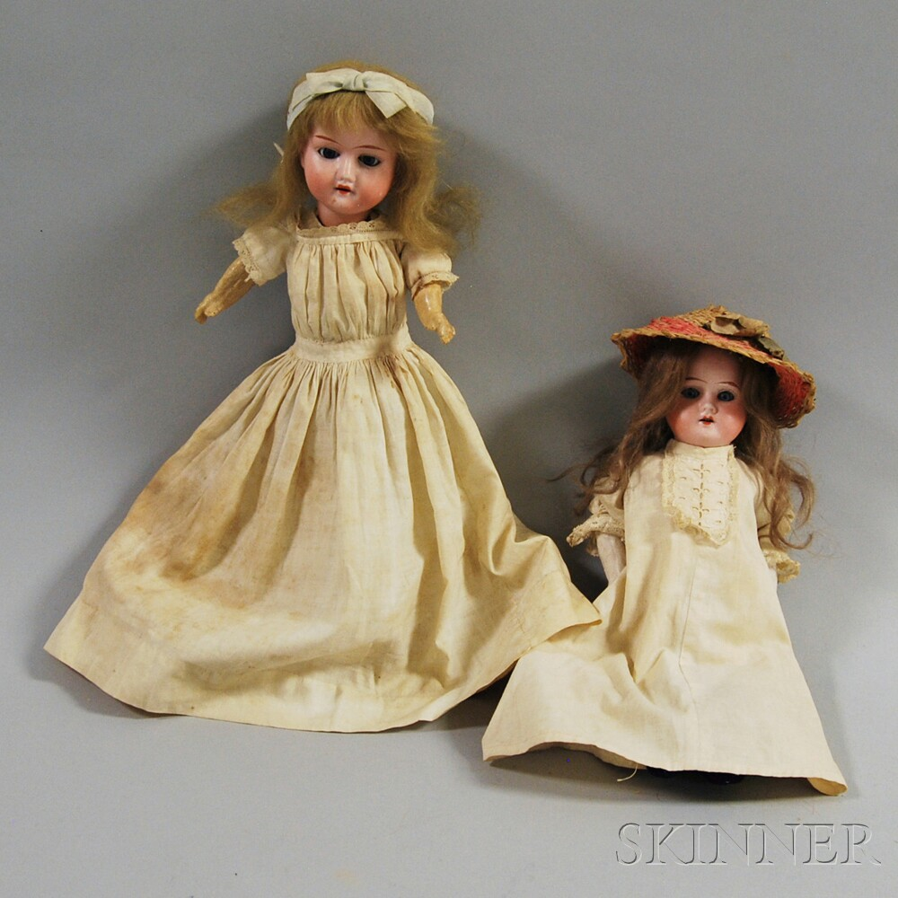 Two Small Bisque Head Girl Dolls