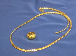 18kt Necklace and an Italian 18kt Gold Band.