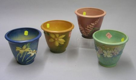 Four Assorted Roseville Pottery Flower Pots