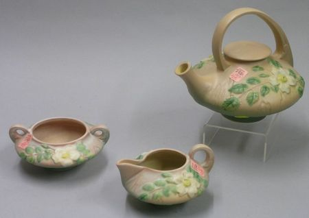 Three-Piece Roseville Pottery White Rose Pattern Tea Set.