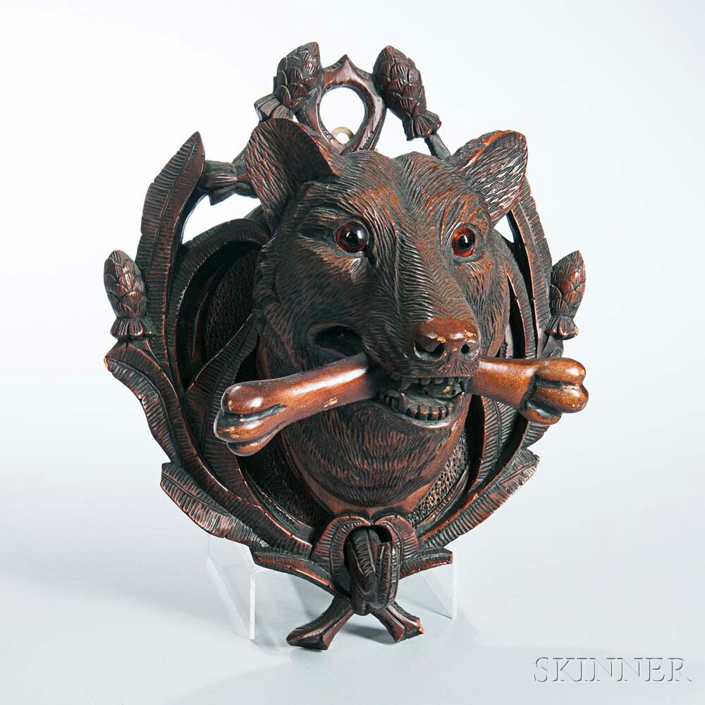 Small Black Forest Carved Plaque of a Dog with a Bone