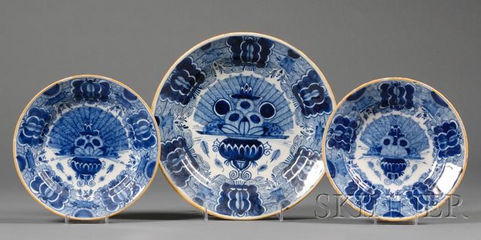 Nine Blue Decorated Tin Glazed Dishes