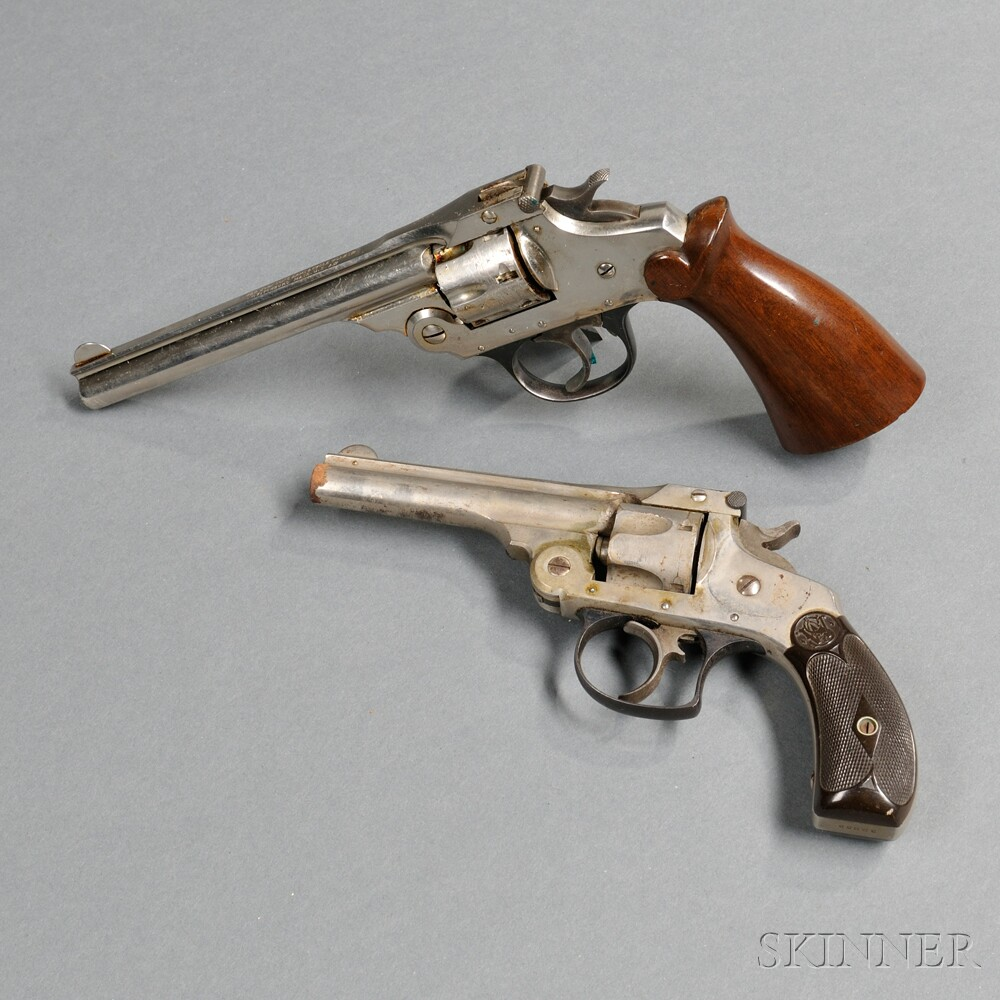 Smith & Wesson 32, and an Iver Johnson .22 Caliber Revolver