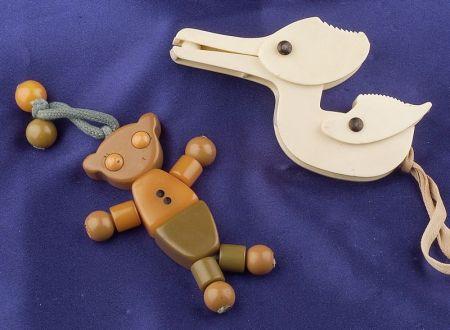 Bakelite Teddy Bear Crib Toy and Celluloid Stork