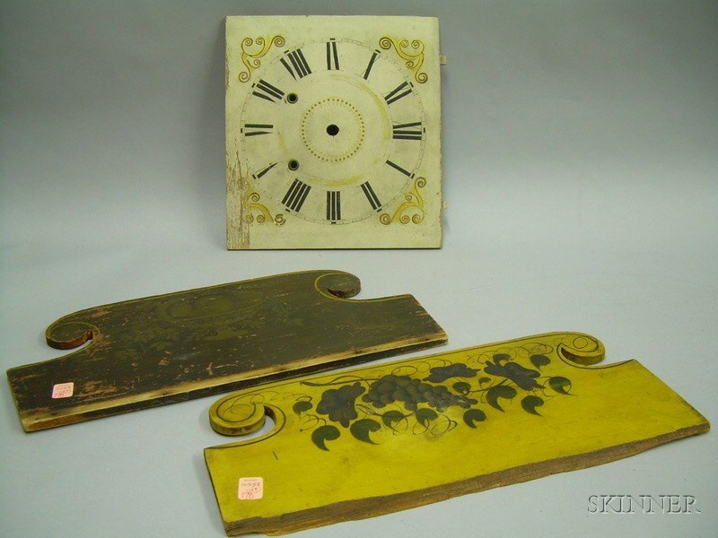Two Painted and Stencil Decorated Wooden Backsplashes and a Painted Wooden Clock Face.