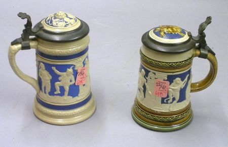 Two Mettlach Relief Decorated Lidded Stoneware Steins