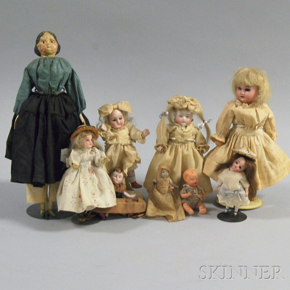 Nine Assorted Small Dolls