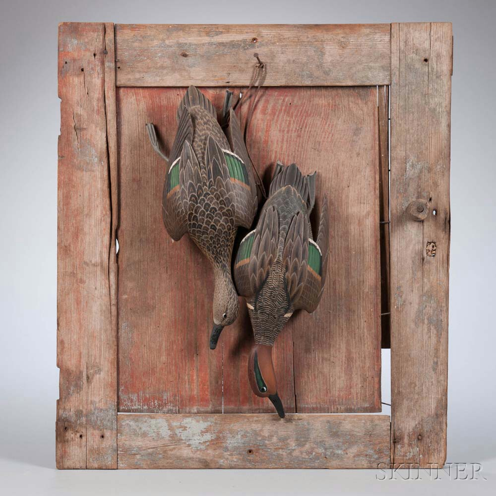 Two Carved and Painted Hanging Teal Figures