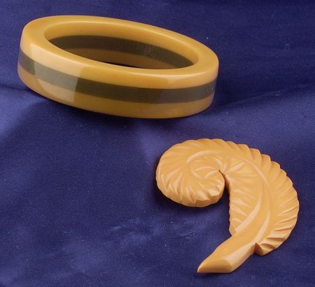 Bakelite Laminate Bangle and Carved Butterscotch Feather Brooch