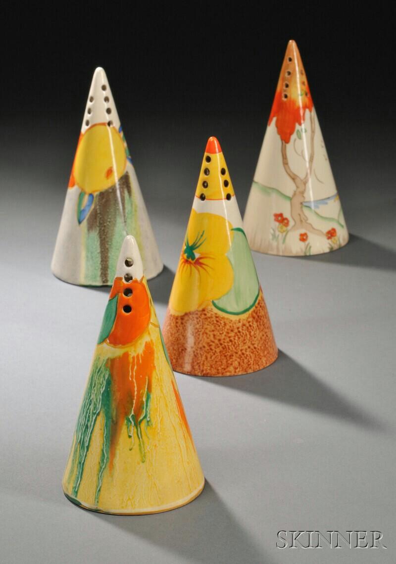 Four Clarice Cliff Bizarre Ware Sugar Shakers