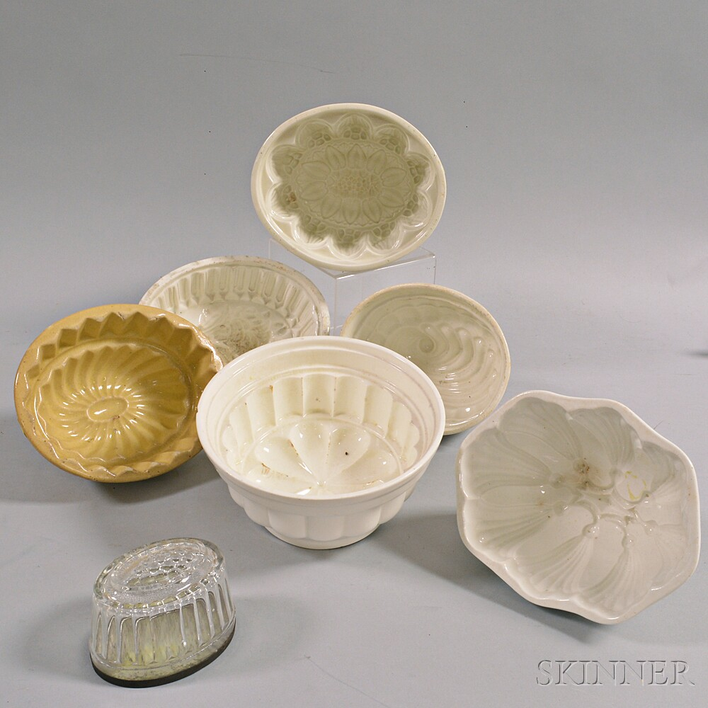 Seven Mostly Ceramic Food Molds