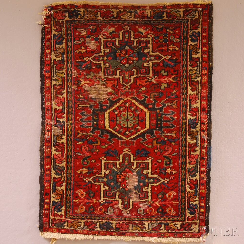 Three Small Oriental Rugs And A Machine-made Rug