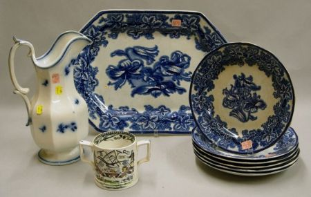 G. Phillips Flow Blue Lobelia Pattern Ironstone Platter and Six Plates, a Flow Blue Ironstone Pitcher, and a St...