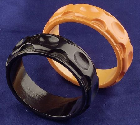 Two Bakelite Carved Thumbprint Bangles