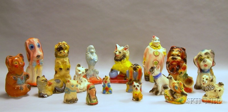 Collection of Approximately Twenty-four Painted Plaster Carnival Figures.