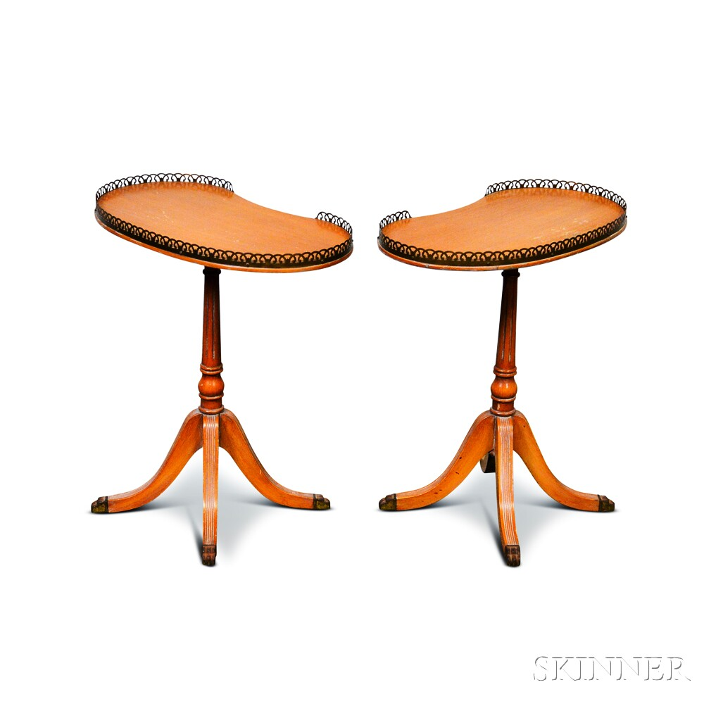 Two Georgian-style Veneered Kidney-shaped Side Tables with Pierced Galleries.     Estimate $100-125