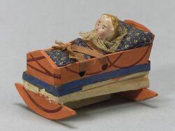 Baby in Cradle Squeak Toy