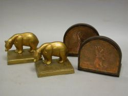 Pair of Arts & Crafts Hammered Copper Scottie Dog Mounted Wooden Bookends and a Pair of Gilt Cast Metal Polar Bear Bookends.