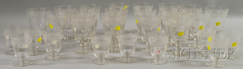 Twenty-eight Piece Etched Colorless Glass Stemware Set