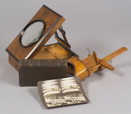 Two Viewers and a Partial Set of  Underwood Stereoscopic Cards