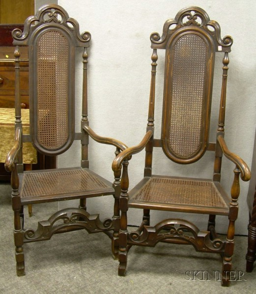 Pair of Paine Furniture Jacobean-style Caned Carved Beechwood Armchairs.