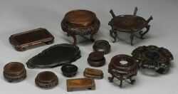 Approximately Fifteen Chinese Carved Hardwood Stands.