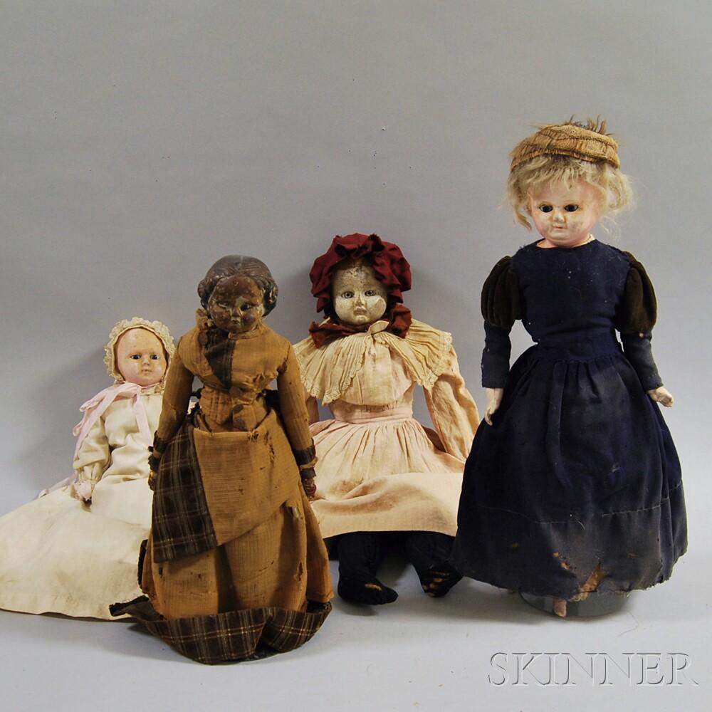 Four Papier-mache Dolls