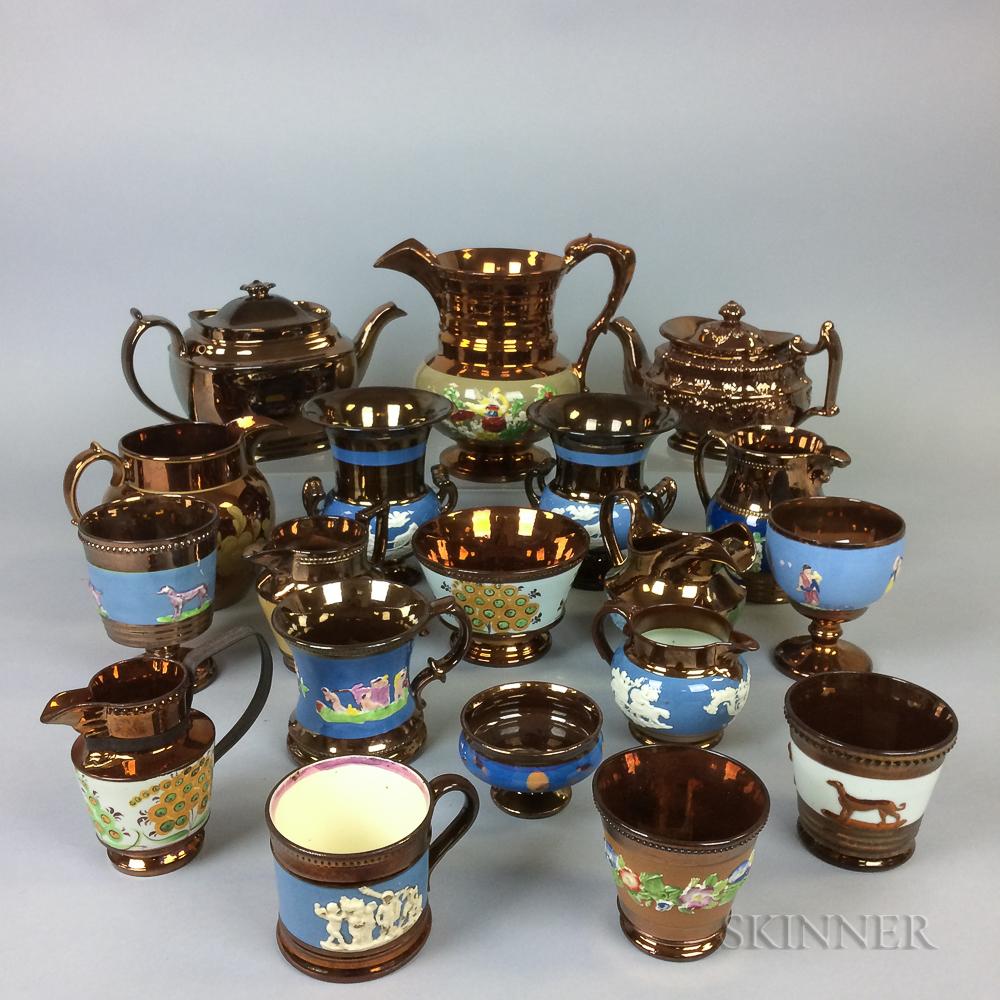 Twenty Copper Lustre Relief-molded Ceramic Vessels.     Estimate $20-200