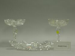 Three Colorless Cut Glass Compotes, a Set of Three Dishes, and a Tray.