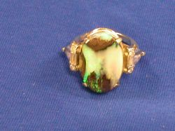 14kt Gold, Opal, and Gemstone Ring.