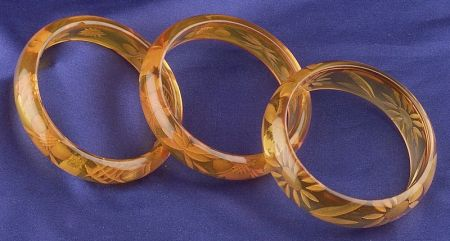 Three Bakelite Reverse Carved Apple Juice Bangles