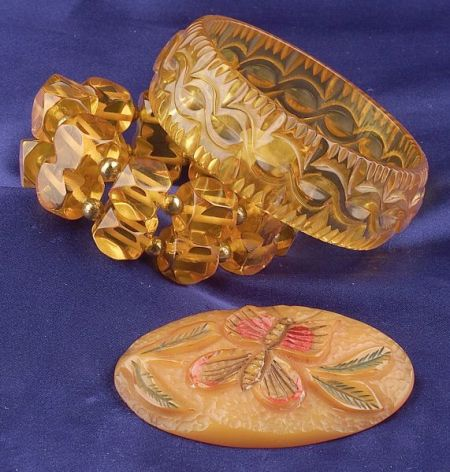 Two Bakelite Apple Juice Bracelets and Painted Butterscotch Butterfly Brooch
