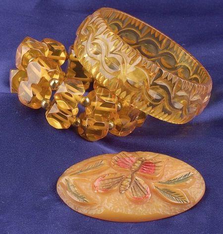 Two Bakelite Apple Juice Bracelets and Painted Butterscotch Butterfly Brooch